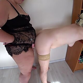 A milf in early pregnancy often fucks with a fat lesbian. A BBW with a strapon undresses and caresses a slender girlfriend. Homemade fetish.