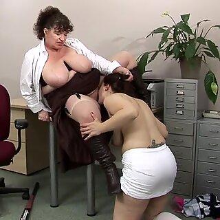Big titted mature teacher fucks a hot student babe