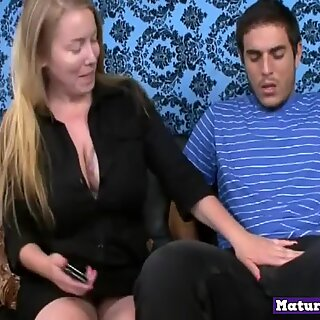 Hugetitted milf tugging massive cock