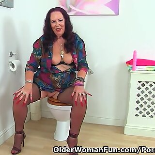 English granny Zadi rams her fanny in bathroom