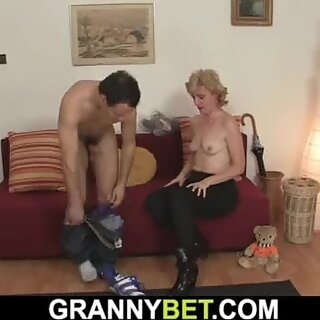Small tits mature blonde spreads legs for him