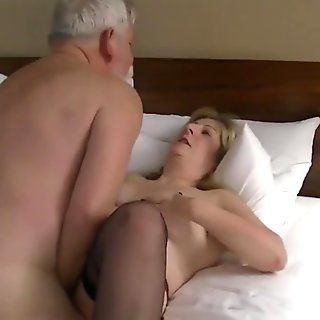 husband films mature man with his wife.
