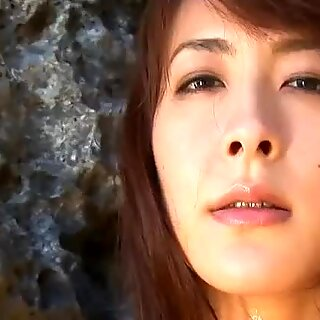 Shiny Asian fairy Rika Kawamura poses on cam on the sea shore