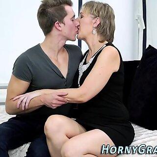 Heeled grandma takes cum