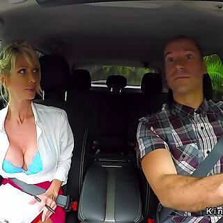 Busty Milf gives footjob to instructor