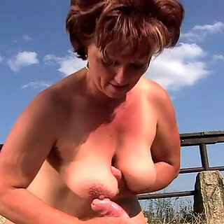 Dirty old grandma sucks off a hard prick in a field and licks ass
