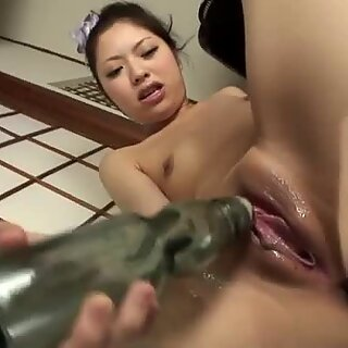 Extremely horny Hana stretchs her tight pussy with a bottle and later tops the dildo jumping