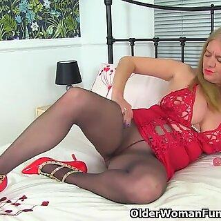 English and nyloned cougar Lily May humps a fake penis