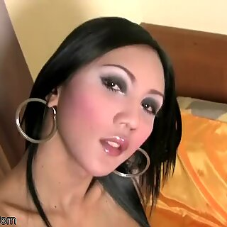 Black hair ladyboy undresses bikini and plays with shecock
