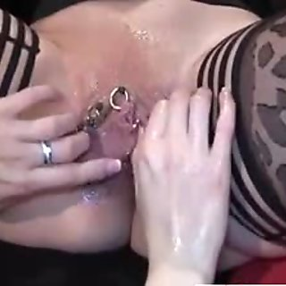 Pierced gaping pussy can fit a whole fist inside.