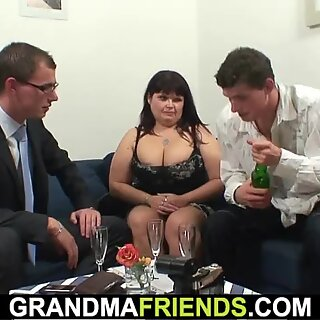 big boobs milf swallows two cocks at once