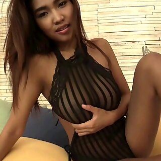 Busty Thai girl playing with herself