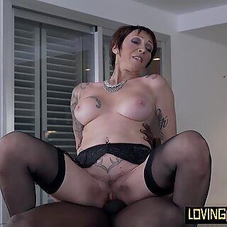 Busty euro mature riding black dick
