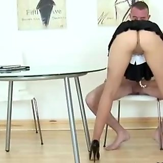 Cheating wife in tiny skirt with stockings sucks cock