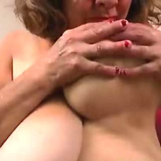 Fat silky babe teases her shaved pussy and masturbates in bed